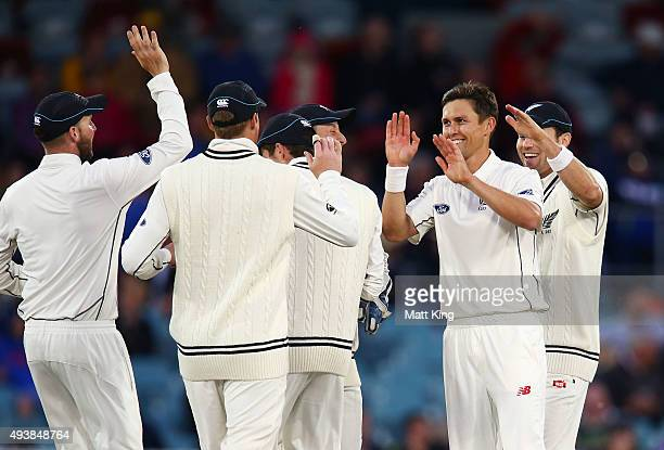 Trent Boult of New Zealand celebrates with team mates after taking the wicket of Joe Burns of the Prime Minister's XI during the tour match between...