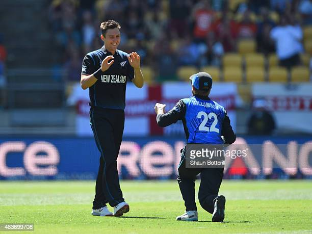 Trent Boult of New Zealand celebrates with teammate Kane Williamson after taking the wicket of Gary Ballance of England during the 2015 ICC Cricket...