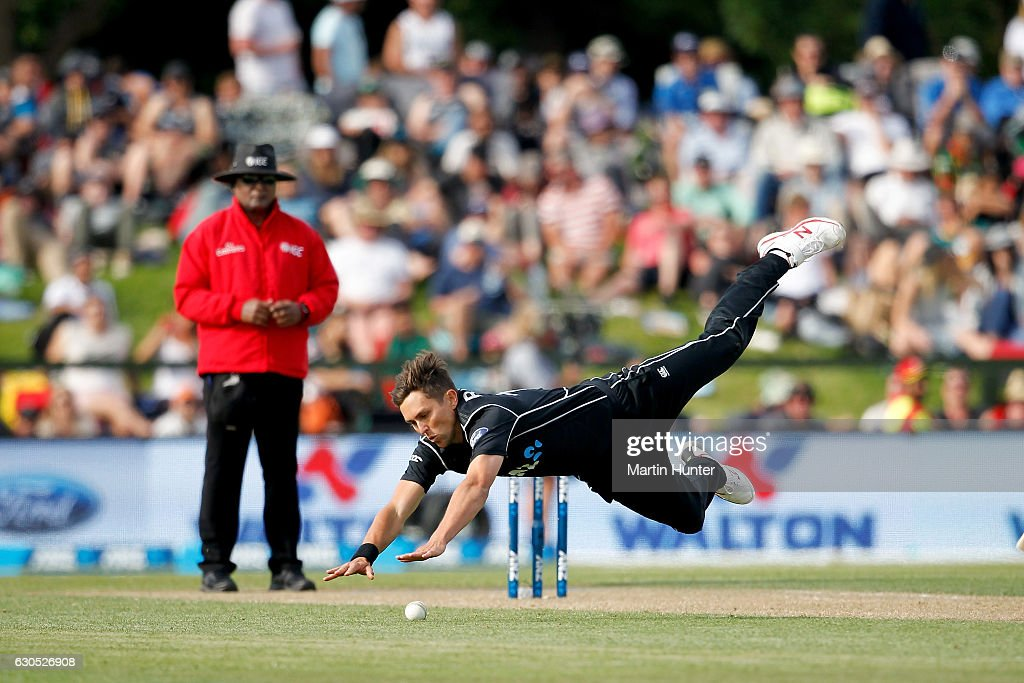 Trent Boult of New Zealand fields the ball after bowing during the first One Day International match between New Zealand and Bangladesh at Hagley Oval on December 26, 2016 in Christchurch, New Zealand.