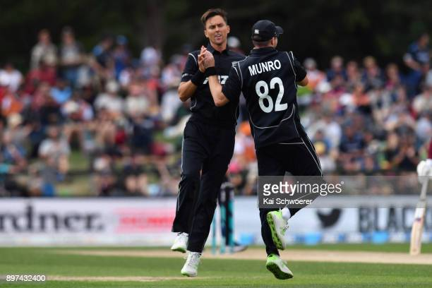 Trent Boult of New Zealand is congratulated by Colin Munro of New Zealand after dismissing Shimron Hetmyer of the West Indies during the One Day...