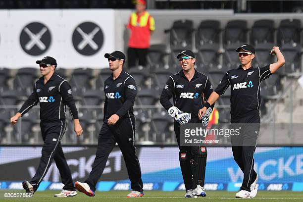 Trent Boult of New Zealand is congratulated by team mates after taking a catch to dismiss Sabbir Rahman of Bangladesh during the first One Day...