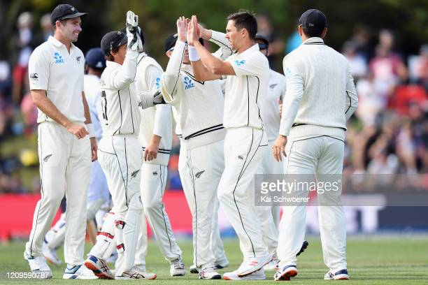 Trent Boult of New Zealand is congratulated by team mates after dismissing Mayank Agarwal of India during day two of the Second Test match between...