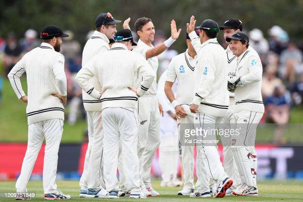 Trent Boult of New Zealand is congratulated by team mates after dismissing Rishabh Pant of India during day three of the Second Test match between...