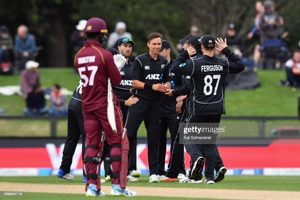 Trent Boult of New Zealand (C) is congratulated by team mates after dismissing Jason Mohammed of the West Indies during the One Day International match during the series between New Zealand and the West Indies at Hagley Oval on December 26, 2017 in Christchurch, New Zealand.