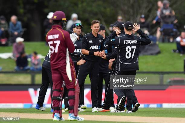 Trent Boult of New Zealand is congratulated by team mates after dismissing Jason Mohammed of the West Indies during the One Day International match...