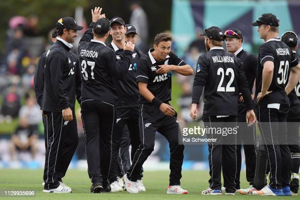 Trent Boult of New Zealand is congratulated by team mates after dismissing Litton Kumar Das of Bangladesh during Game 2 of the One Day International...