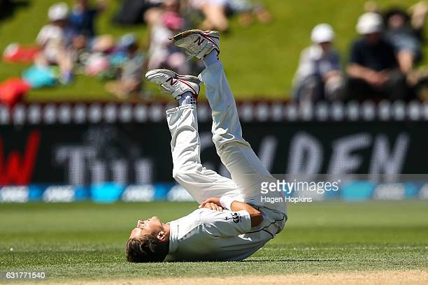 Trent Boult of New Zealand reacts after dropping a catch during day five of the First Test match between New Zealand and Bangladesh at Basin Reserve...