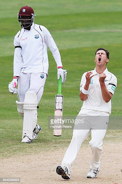 Trent Boult of New Zealand reacts to another dropped catch during day five of the first test match between New Zealand and the West Indies at...