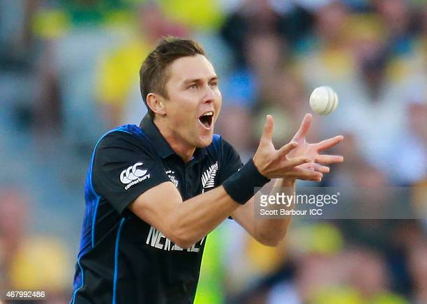 Trent Boult of New Zealand takes a catch from his own bowling to dismiss Aaron Finch of Australia during the 2015 ICC Cricket World Cup final match...