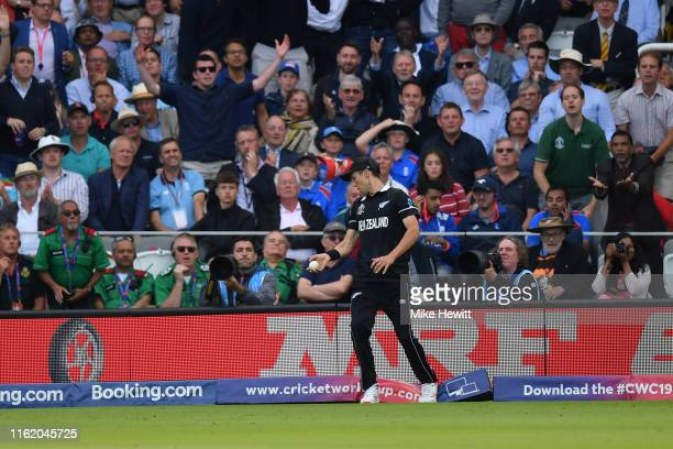 Trent Boult of New Zealand treads on the boundary after taking a catch from Ben Stokes during the Final of the ICC Cricket World Cup 2019 between...