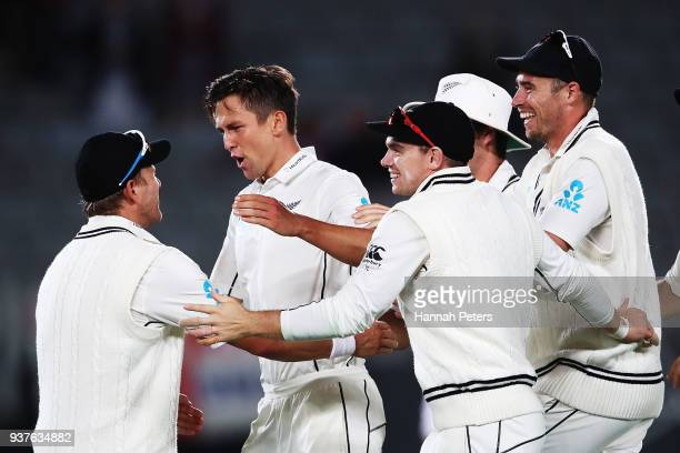 Trent Boult of the Black Caps celebrates after claiming the wicket of Joe Root of England during day four of the First Test match between New Zealand...
