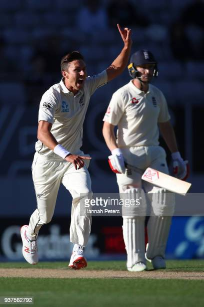 Trent Boult of the Black Caps celebrates the wicket of Alastair Cook of England during day four of the First Test match between New Zealand and...