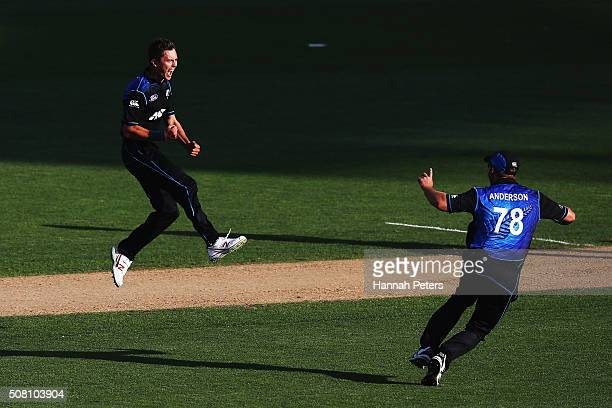 Trent Boult of the Black Caps celebrates the wicket of Mitchell Marsh of Australia with Corey Anderson of the Black Caps during the One Day...
