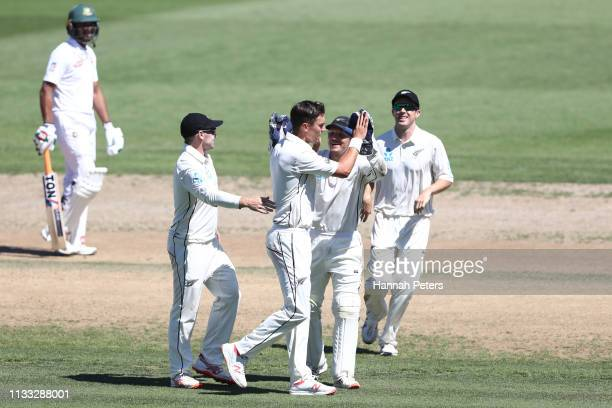 Trent Boult of the Black Caps celebrates the wicket of Soumya Sarkar of Bangladesh during day four of the First Test match in the series between New...