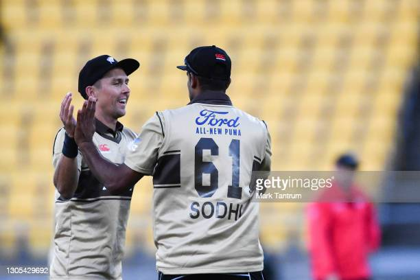 Trent Boult of the Black Caps congratulates Ish Sodhi of the Black Caps catching out Matthew Wade of Australia during game four of the International...