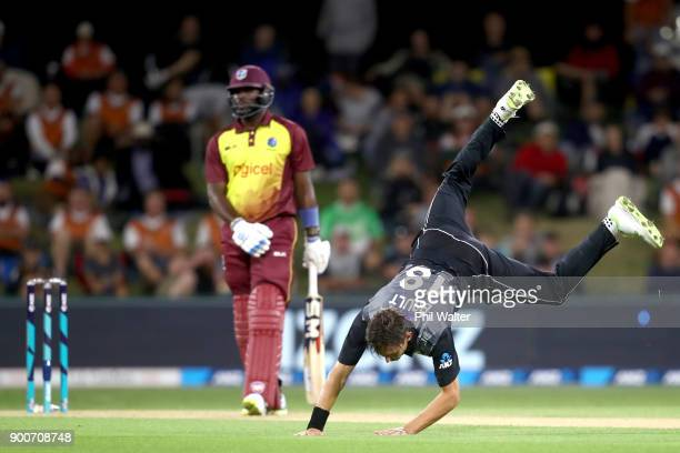 Trent Boult of the New Zealand Black Caps fields the ball during game three of the Twenty20 series between New Zealand and the West Indies at Bay...