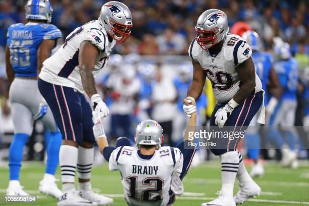 Trent Brown of the New England Patriotsat and Shaq Mason help their quarterback Tom Brady of the New England Patriots up off the field after a sack...