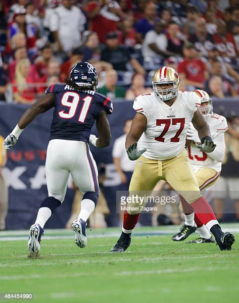Trent Brown of the San Francisco 49ers defends during the game against the Houston Texans at NRG Stadium on August 15 2015 in Houston Texas The...