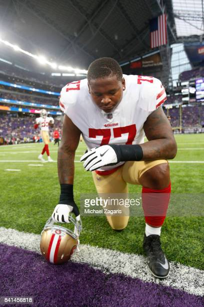 Trent Brown of the San Francisco 49ers takes a knee on the field prior to the game against the Minnesota Vikings at US Bank Stadium on August 27 2017...