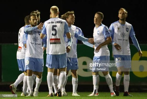 Trent Buhagiar is congratulated by Adam Le Fondre and Siem de Jong after scoring the first goal during the FFA Cup quarterfinal match between...