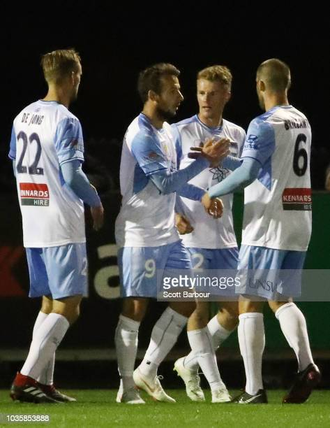 Trent Buhagiar is congratulated by Siem de Jong , Adam Le Fondre and and Joshua Brillante after scoring the first goal during the FFA Cup...
