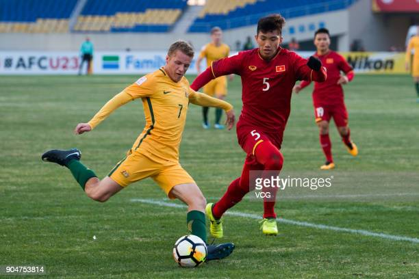 Trent Buhagiar of Australia and Doan Van Hau of Vietnam vie for the ball during the AFC U23 Championship Group A match between Vietnam and Australia...