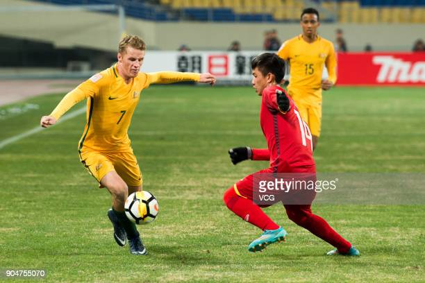 Trent Buhagiar of Australia and Le Thanh Binh of Vietnam vie for the ball during the AFC U23 Championship Group A match between Vietnam and Australia...