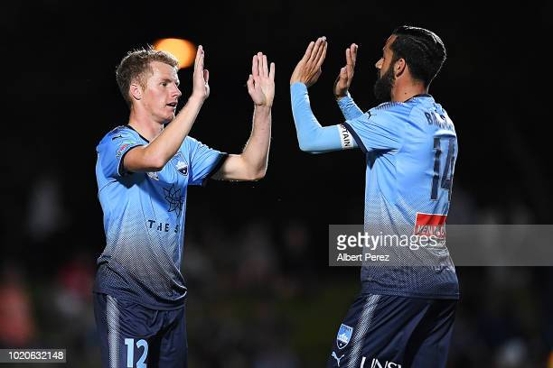 Trent Buhagiar of Sydney FC celebrates with team mates after scoring a goal during the FFA Cup round of 16 match between Cairns FC and Sydney FC at...