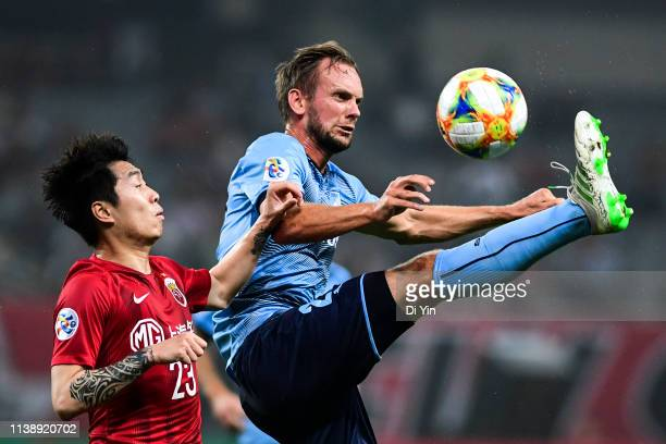Trent Buhagiar of Sydney FC gets away from challenge from Fu Huan of Shanghai SIPG during the AFC Champions League Group H match between Sydney FC...