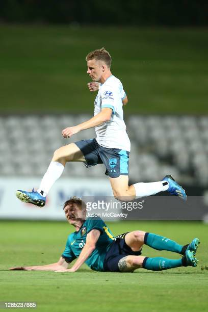 Trent Buhagiar of Sydney FC is challenged by Kye Rowles of the Olyroos during the match between the Australian Under 23 Olyroos and Sydney FC at...