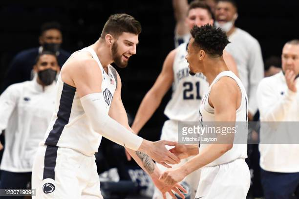 Trent Buttrick and Myreon Jones of the Penn State Nittany Lions celebrate a shot in the second half during a college basketball game against the...