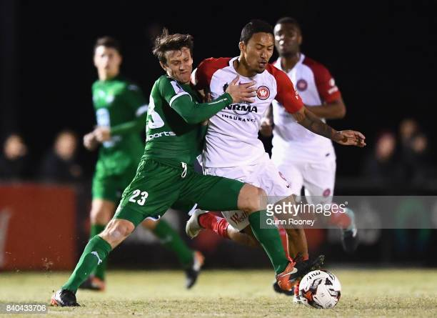 Trent Clulow of Bentleigh and Kearny Baccus of the Wanderers compete for the ball during the round of 16 FFA Cup match between Bentleigh Greens and...