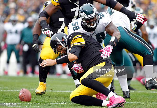 Trent Cole of the Philadelphia Eagles causes Ben Roethlisberger of the Pittsburgh Steelers to fumble during the game on October 7 2012 at Heinz Field...