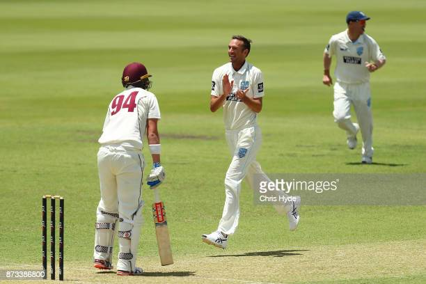 Trent Copeland of New South Wales celebrates with team mates after Matthew Renshaw of Queensland during day one of the Sheffield Shield match between...