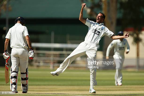 Trent Copeland of the Blues celebrates taking the wicket of Rob Quiney of the Bushrangers during day two of the Sheffield Shield match between...