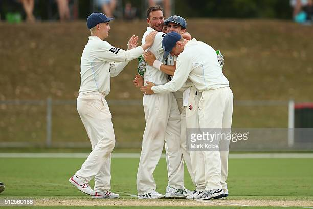 Trent Copeland of the Blues celebrates with Nic Maddinson Sean Abbott and Ben Rohrer of the Blues after taking his fifth wicket during day three of...
