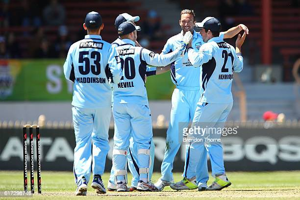 Trent Copeland of the Blues celebrates with team mates after claiming the wicket of Nathan Reardon of the Bulls during the Matador BBQs One Day Cup...