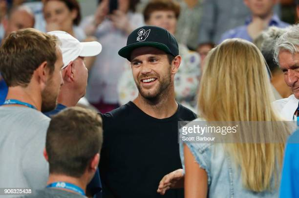 Trent Cotchin a supporter of Ashleigh Barty of Australia smiles after she won her second round match against Camila Giorgi of Italy on day four of...