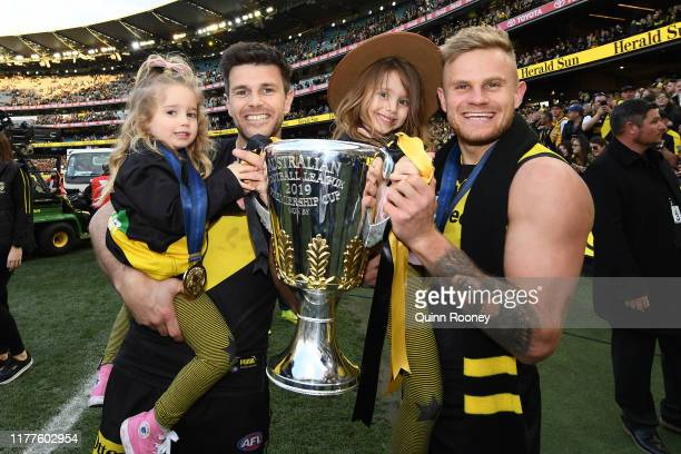 Trent Cotchin and Brandon Ellis of the Tigers hold the Premiership Cup after winning the 2019 AFL Grand Final match between the Richmond Tigers and...