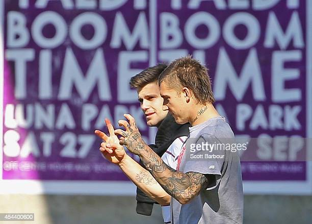 Trent Cotchin and Dustin Martin of the Tigers talk as they walk around the MCG during a Richmond Tigers AFL recovery session on August 31 2014 in...