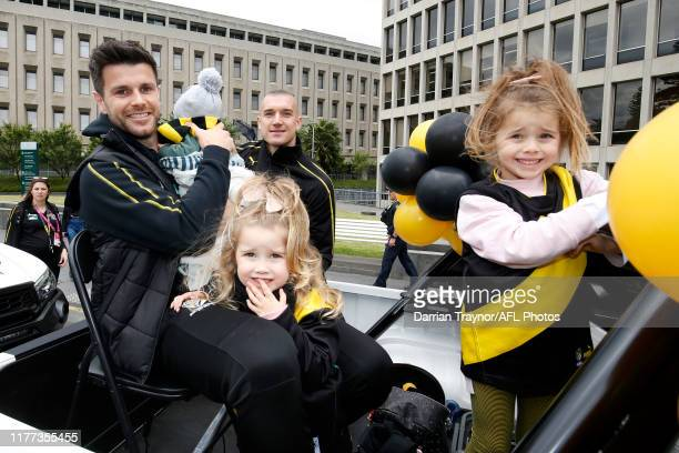 Trent Cotchin and Dustin Martin of the Tigers with Trent's Children are seen before the 2019 AFL Grand Final Parade on September 27, 2019 in...