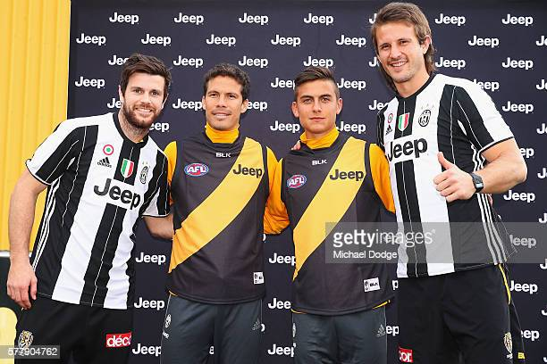 Trent Cotchin and Ivan Maric of the Tigers pose with Hernanes and Paulo Dybala of Juventus during a Richmond Tigers AFL and Juventus FC media...