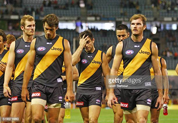 Trent Cotchin and the Richmond Tigers leave the field after losing the round three AFL match between the Richmond Tigers and the Adelaide Crows at...