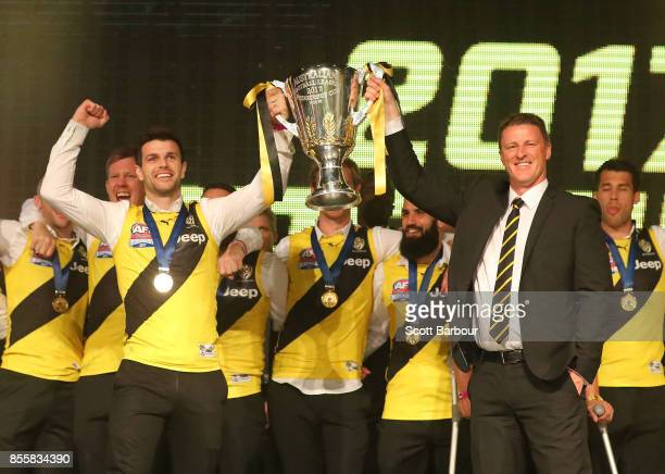 Trent Cotchin and the Tigers and Damien Hardwick coach of the Tigers celebrate with the AFL Premiership Cup during the Richmond Tigers AFL Grand...