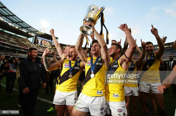 Trent Cotchin captain of the Tigers celebrates victory with team mates as they leave the pitch during the 2017 AFL Grand Final match between the...