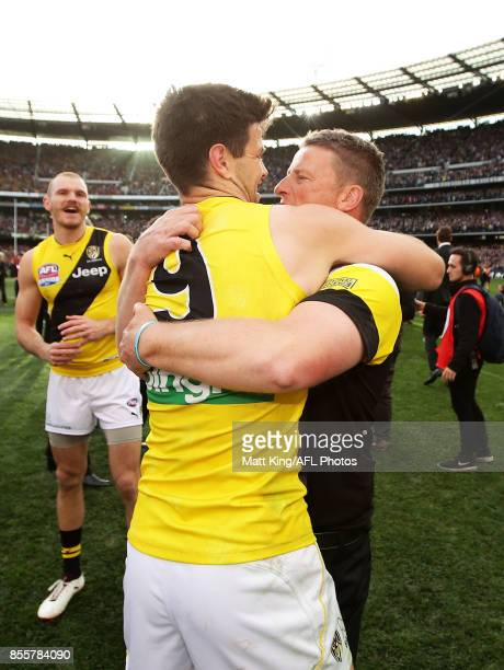 Trent Cotchin captain of the Tigers celebrates victory with Tigers head coach Damien Hardwick after the 2017 AFL Grand Final match between the...