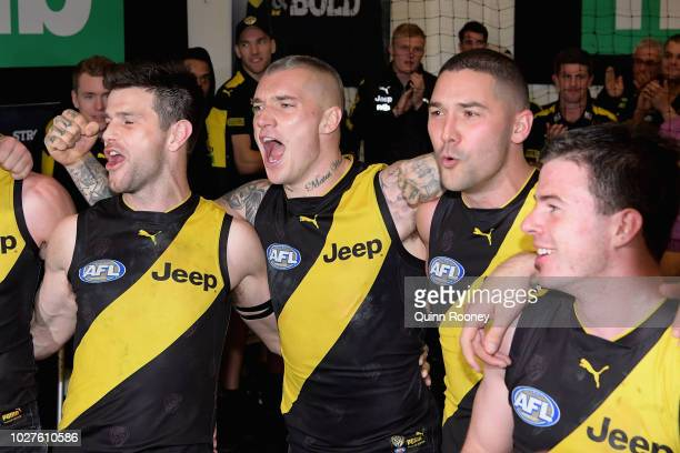 Trent Cotchin Dustin Martin Shaun Grigg and Jack Higgins of the Tigers sing the song in the rooms after winning the AFL First Qualifying Final match...