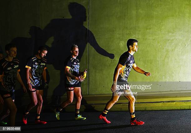Trent Cotchin of the Richmond Tigers leads his side onto the field during the round three AFL match between the Richmond Tigers and the Adelaide...