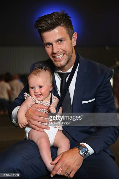 Trent Cotchin of the Richmond Tigers poses with daughter Mackenzie Foxx after being presented his Brownlow Medal during the 2012 Brownlow Medal...