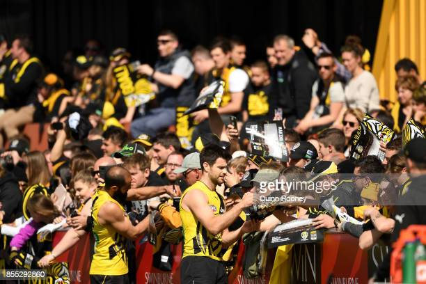 Trent Cotchin of the Tigers and Bachar Houli sign autographs during a Richmond Tigers AFL training session at Punt Road Oval on September 29 2017 in...